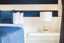 Lamp in luxury hotel bedroom - vintage film tone effect style processing